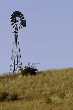 Old windmill pump on a hill top. Stock Photo - 5733367