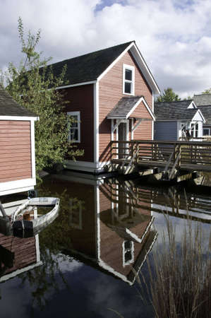 Heritage homes along the fraser river. Reflection of home in the waterway. Stock Photo