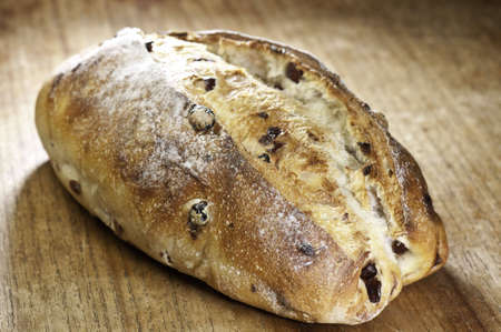 backlite: Backlite sourdough loaf of bread and shallow depth of field. Stock Photo
