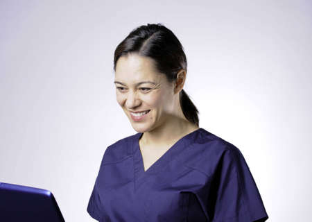 Medical asian young lady using the computor.She is 34 view. Stock Photo