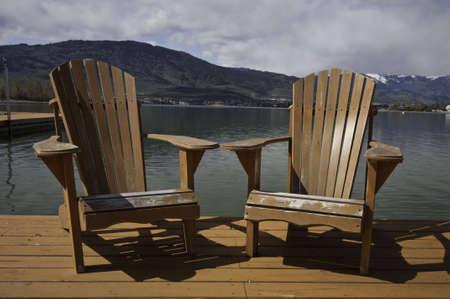 adirondack chair two adirondack chairs on the dock stock photo