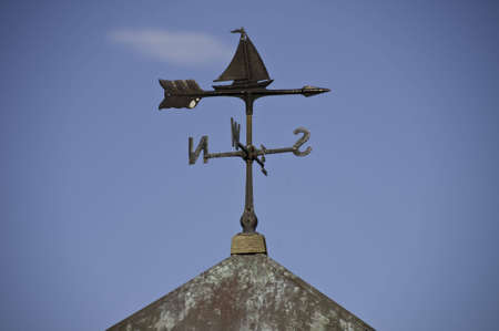 Weather vane on a roof top. Stock Photo - 6999059