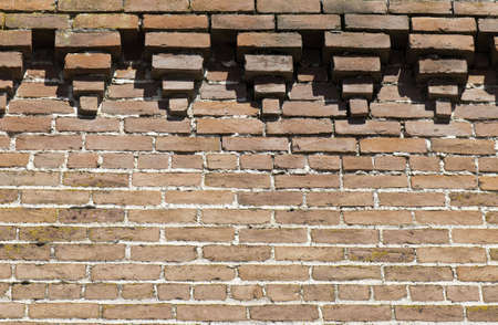 Brick wall with fancy outcropping at the top.