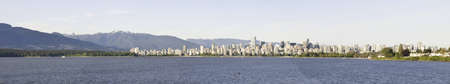 Panoramic water view of the city of Vancouver. Stanley Park is on the right side