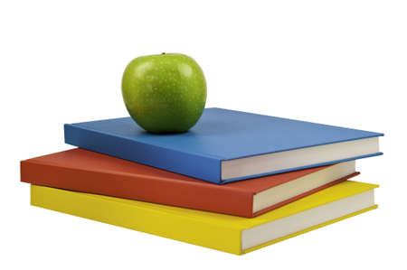 Three books with a green apple on top.This has a clipping path.