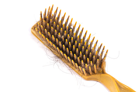 adverse: old comb and hair loss on white back ground,hair loss concept,copy space Stock Photo