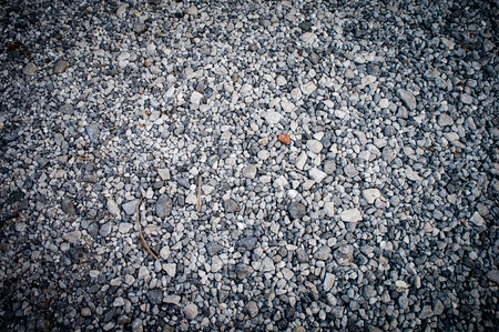 The road surface made ​​of small pieces of gray rock. photo