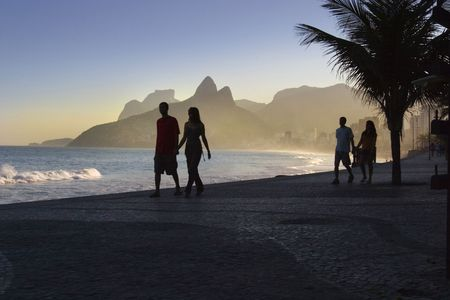 couples walking on beach front in rio