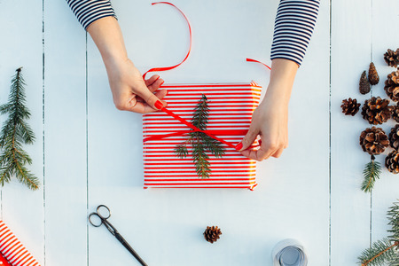 wrappings: Gift wrapping. Woman packs gifts, step by step Stock Photo