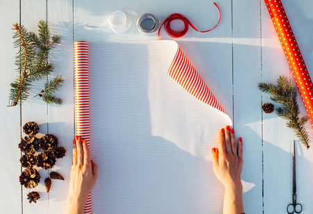 Gift wrapping. Woman packs gifts, step by step Standard-Bild