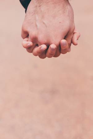 happy teenagers: Closeup of young couple in love holding hands Stock Photo