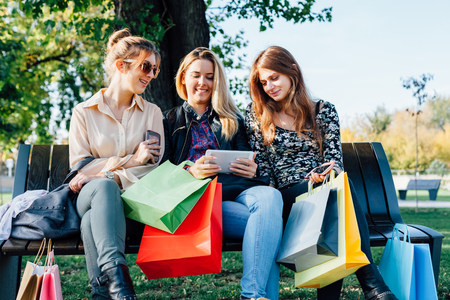 Girls with bags after shopping Stock Photo