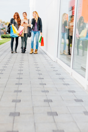 walk in closet: Happy girls walking the malls after shopping with copy space