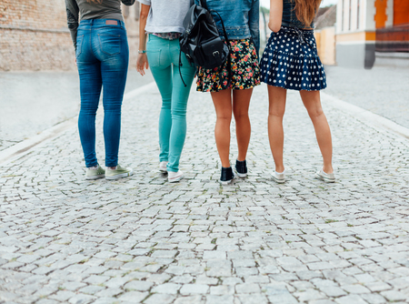 girls back to back: Best friend walking down the street Stock Photo