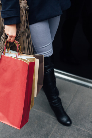 with bag: Closeup of woman carrying couple of shopping bags
