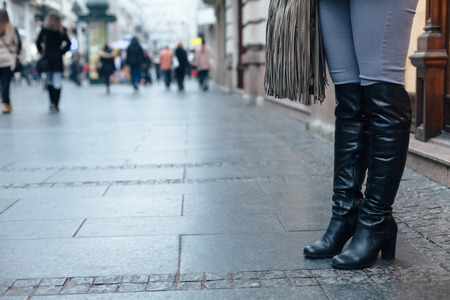 Closeup of womens boots on the city after shopping Stock Photo