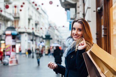 Beautiful woman carrying shopping bags on a city street