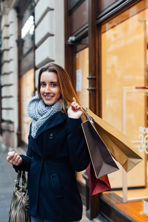 after shopping: Smiling girl with shopping bags after shopping Stock Photo