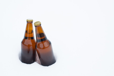chilling: Two bottles of beer chilling in snow