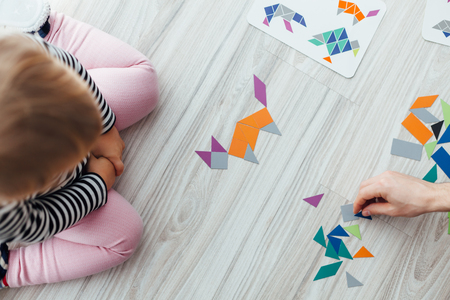 Top view of Girl learning how to sort the puzzle
