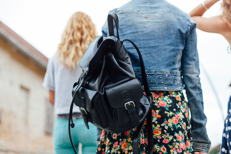 leather bag: Closeup of teen girl with leather bag