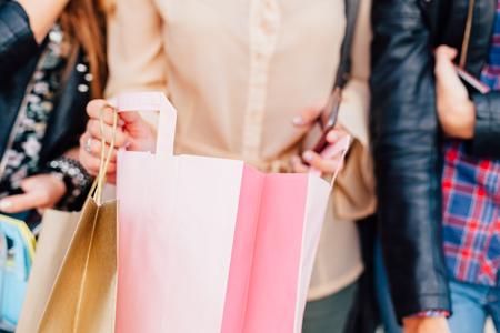 christmas shopping bag: Closeup of girl open shopping bag with gift