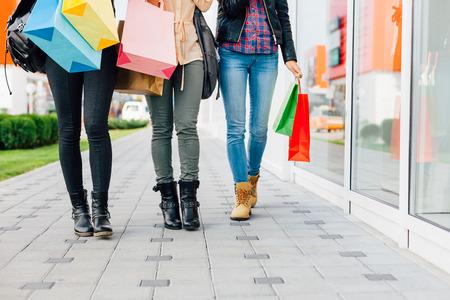 walk in closet: Closeup of  three girls walking with shopping bags Stock Photo
