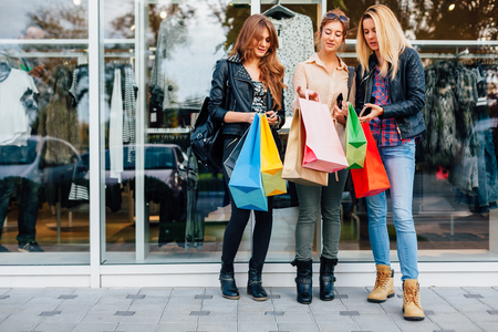 walk in closet: Happy teens with shopping bags are satisfied with the purchase