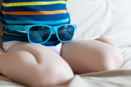 3 year old boy: Closeup of little boy having fun with sunglasses