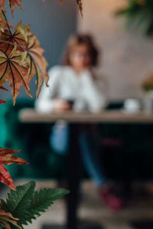 cute teen girl: Woman in a cafe. Blurred background Stock Photo