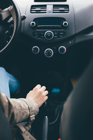 gearshift: Woman driving car. Hand on a gearshift. Car interior.