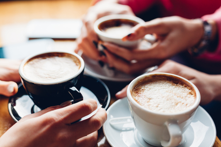 Closeup of three girls with coffee cups Stock Photo