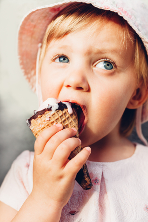 smeared: Closeup of smeared little girl eating ice cream