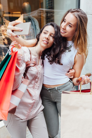 after shopping: Happy women with shopping bags making photo after shopping Stock Photo