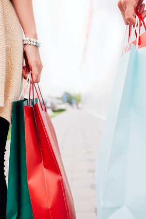 Closeup of woman and man with shopping bags Stock Photo