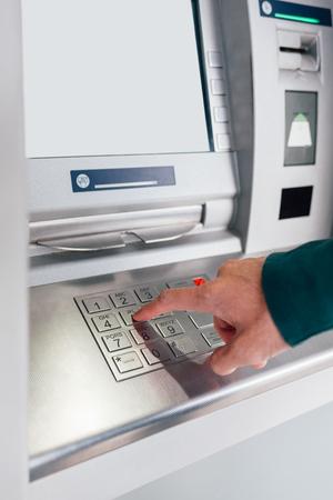 pin code: Closeup of hand entering PIN code on ATM machine keypad Stock Photo