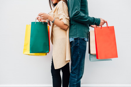 Closeup of man and woman holding their shopping bags Standard-Bild