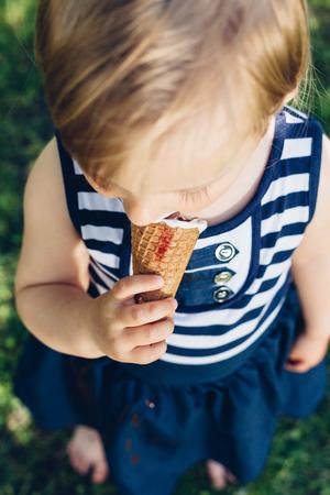 licking: Little girl licking ice cream