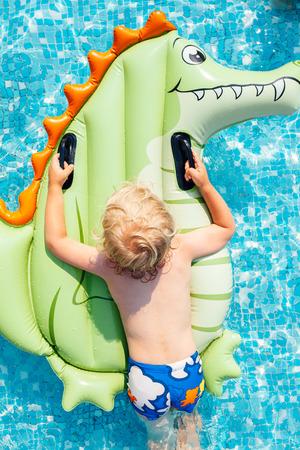 little boy swimming: Little boy swimming with mattress pool