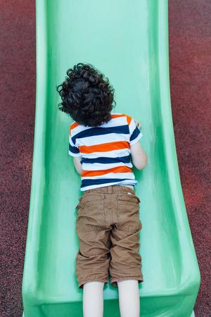toboggan: Little boy climbing on toboggan