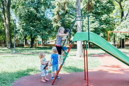 toboggan: Children climbing on toboggan