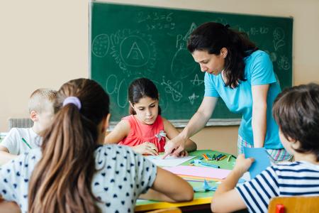 teaches: Teacher teaches children in classroom