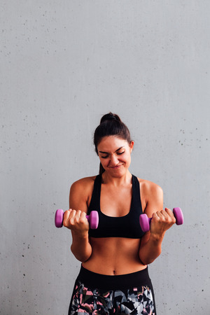 muscle toning: Woman training with dumbbells, copy space area for your text Stock Photo