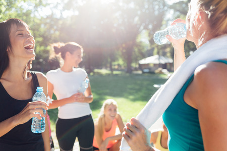 Group of sports women refreshing after workout