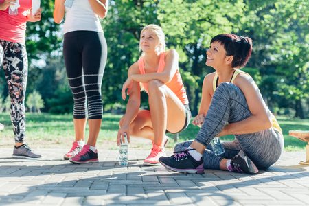 Happy sports women resting after workout Stock Photo
