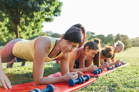 endurance: Closeup of women doing endurance exercise in the park Stock Photo