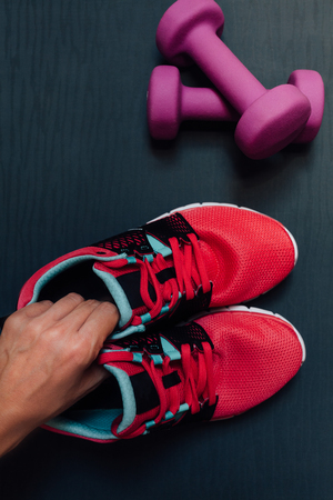 Woman is preparing for training in the gym