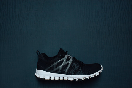 legging: Mans running shoes with empty space for your ad Stock Photo