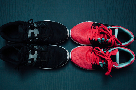 Womans and mans running shoes in closeup