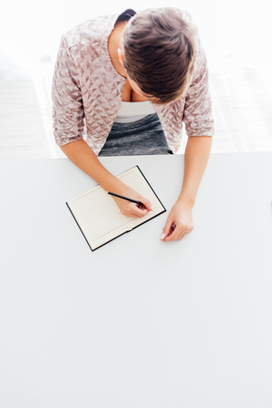 empty space: Woman writing notes with empty space